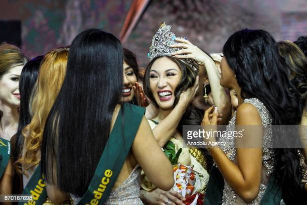 Miss Earth 2017 Karen Ibasco is greeted by fellow candidates during the coronation night at the Mall of Asia Arena in Pasay City south of Manila...