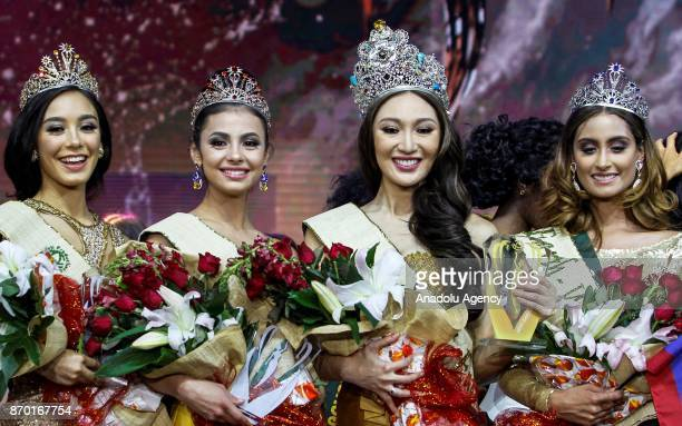 Miss Earth Air Nina Robinson of Australia Miss Earth Fire Lada Akimova of Russia Miss Earth Water Juliana Franco of Colombia and Miss Earth Karen...