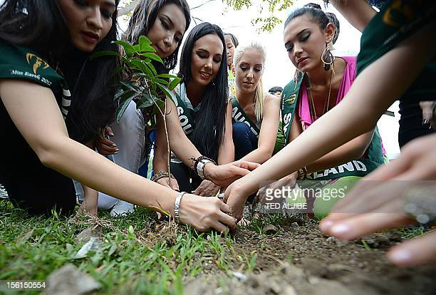 Miss Earth contestants along with street children plant a tree during a tree planting activity at a governmentrun shelter for street children in...
