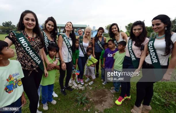 Miss Earth contestants Chelsy Liven of Indonesia Battsetseg Turbat of Mongolia Tamerin Michele Jardine of South Africa Jenna Seymour of Australia Lea...