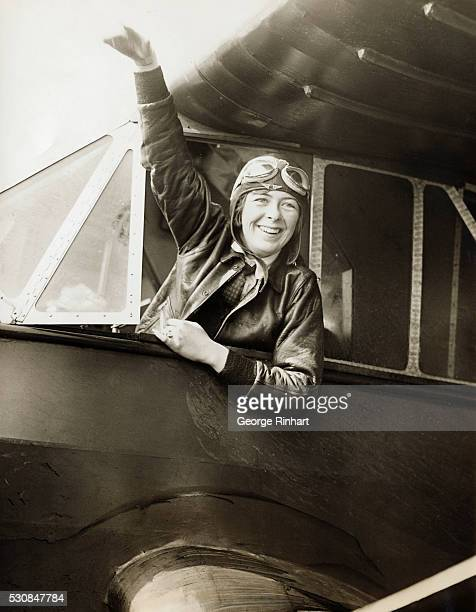 Miss Elinor Smith 17 years old waving to the crowd of thousands just after she landed here after establishing a new women's flight endurance record...