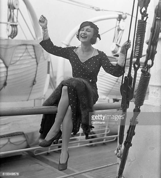 Miss Elizabeth Hawes a wellknown American modiste is pictured on the SS Acquitania on her return here from France Miss Hawes was literally barred...