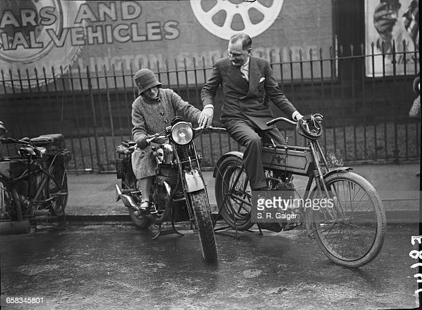 Miss Ellen Wilkinson MP and motorcycle dealer Kaye Don discussing the 1930 and 1902 Matchless motorcycles at a preview of the London Motorcycle Show...