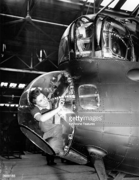 Miss Elsie Yates working on the nose of an Avro Lancaster bomber during World War II, 16th April 1943.