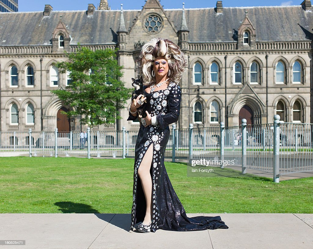 Miss Emma Royd and her dog 'Mr Big' pose at the start of a parade during a Community Pride event on September 14, 2013 in Middlesbrough, England. The parade was the culmination of a three day event to raise awareness and celebrate Lesbian, Gay, Bi-sexual and Transgender life.