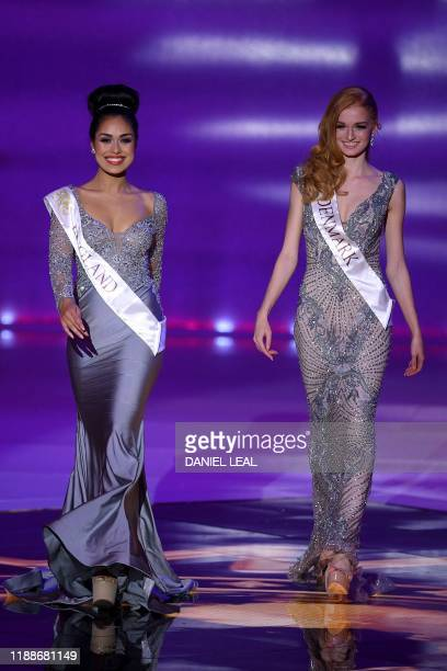 Miss England Bhasha Mukherjee and Miss Denmark Natasja Kunde appear during the the Miss World Final 2019 at the Excel arena in east London on...