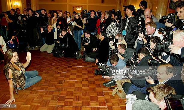 Miss England Daniella Luan poses in front of a pack of photographers at a Miss World press conference December 5 2002 in London The Miss World...