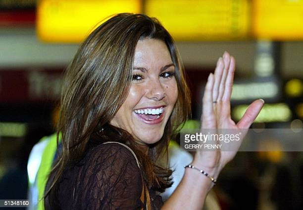 Miss England Daniella Luan waves to the crowd upon her arrival at Gatwick Airport 24 November 2002 Miss World contestants arrived in London on Sunday...