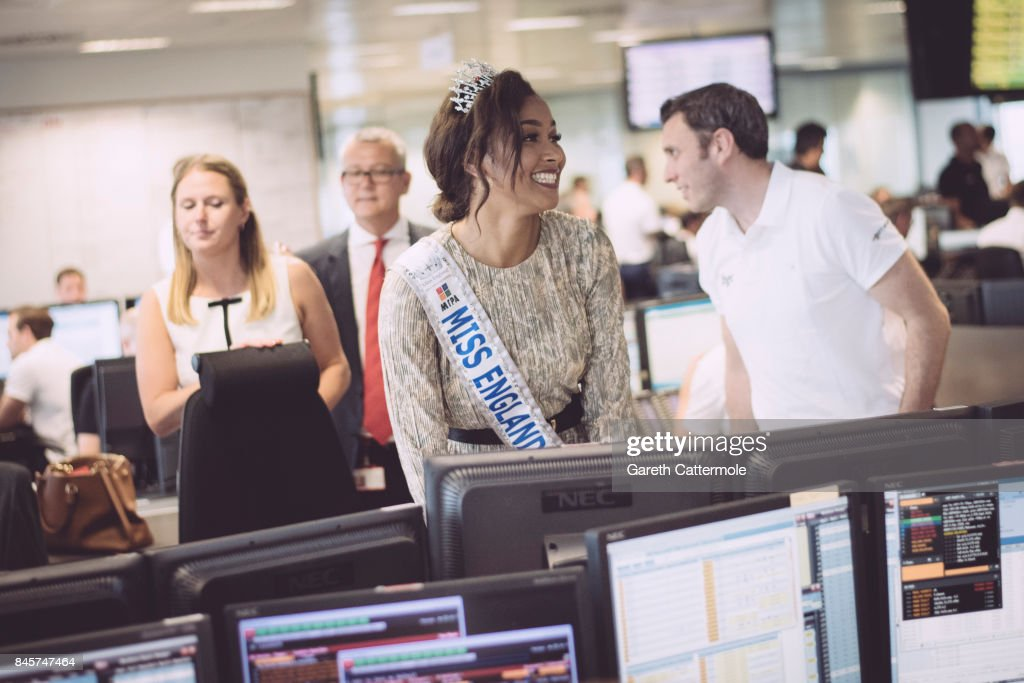 Miss England Elizabeth Grant (C), representing Sir Stanley Matthews Coaching Foundation, makes a trade at BGC Charity Day on September 11, 2017 in London, United Kingdom.