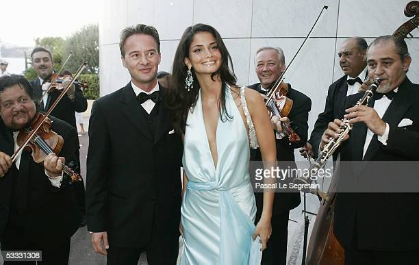 Miss Europe 2005 Shermine Sharivar of Germany and Austrian fashion designer Gottfried arrive at the 57th Red Cross Ball on August 5 2005 in Monte...