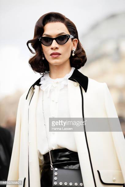 Miss Fame wearing Miu Miu white jacket and black stud bag outside the Miu Miu show during Paris Fashion Week Womenswear Fall/Winter 2020/2021 Day...