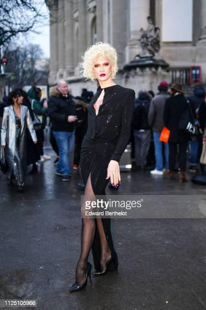 Miss Fame wears a black dress black tights black heels shoes outside Alexandre Vauthier during Paris Fashion Week Haute Couture Spring Summer 2020 on...