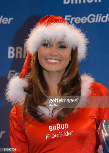 Miss February 2001 Lauren Michelle Hill during Playboy Playmates and Braun Freeglider Host PreHoliday Personal Shave Session In Times Square at Times...
