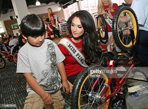 Miss Florida USA Lissette Garcia attends a bike build in celebration of the 60th anniversary of the Miss USA Pageant and the 70th anniversary of the...