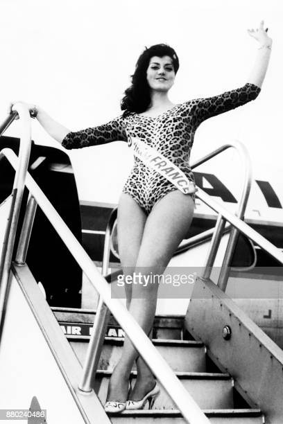 Miss France 1965 Christiane Sibellin waves at her arrival in London on 13 November 1965 / AFP PHOTO / CENTRAL PRESS /