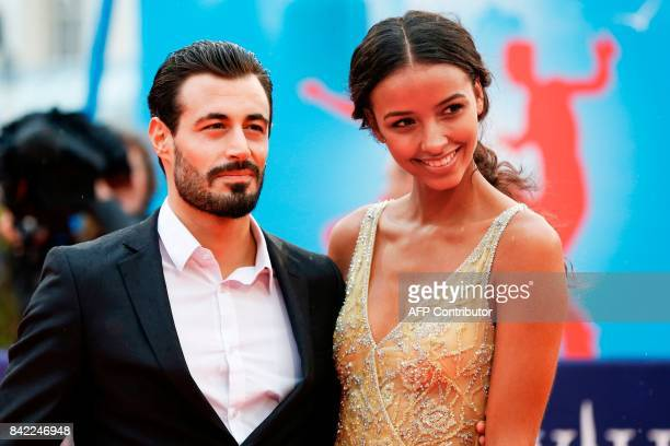 Miss France 2014 and Miss Universe 2015 3rd Runnerup Flora Coquerel and her companion Ugo Ciulla pose as they arrive for the screening of the film...