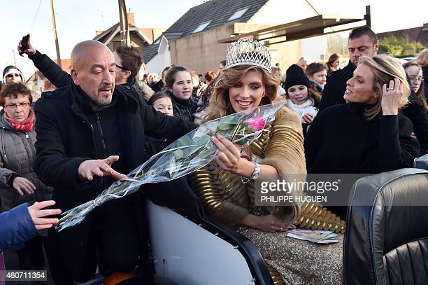 Miss France 2015 Camille Cerf receives a rose flanked by Miss France society president Sylvie Tellier as she returns to her hometown of Coulogne...