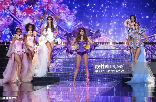 Miss France 2016 Miss Universe 2016 and president of the jury Iris Mittenaere performs with contestants during the Miss France 2018 pageant in...