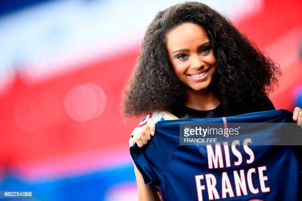 Miss France 2017 Alicia Aylies poses with a jersey ahead of the UEFA Women's Champions League quarter-final second leg football match between Paris...