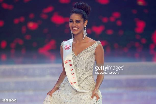 Miss France Aurore Andree Raphaelle Kichenin walks onstage during the 67th Miss World contest final in Sanya on the tropical Chinese island of Hainan...