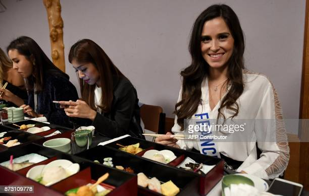 Miss France Maeva BalanMerceron eats Japanese food with other Miss International Beauty Pageant contestants at the SushiZanmai restaurant near the...
