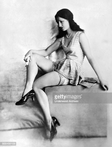 Miss France Mlle Raymonde Allaine models the latest bathing suit by Jenny a white creation trimmed with beads of gold Paris France circa 1925