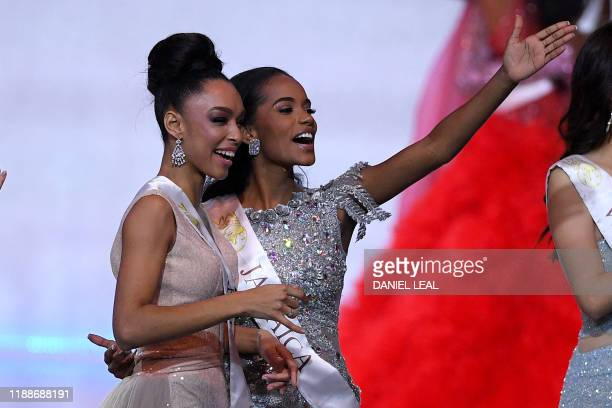 Miss France Ophely Mezino and Miss Jamaica ToniAnn Singh react during the the Miss World Final 2019 at the Excel arena in east London on December 14...