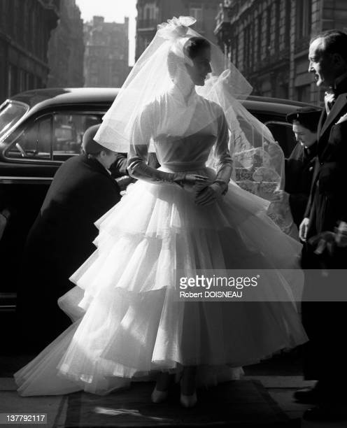 Miss Francoise D'Origny became Viscountess D'Harcourt, her bridal costume had been especially designed fo her by Schiaparelli with a dress and coiffe Normande of tulle and satin embroidered with pearls and strass, in 1952.