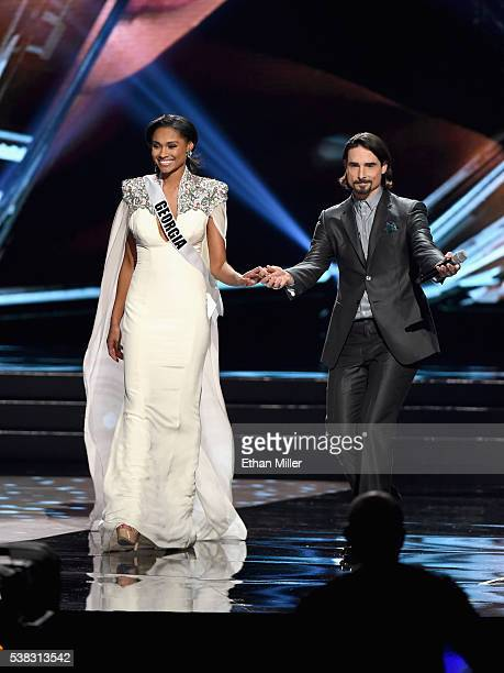 Miss Georgia USA 2016 Emanii Davis walks onstage while singer Kevin Richardson of the Backstreet Boys performs during the 2016 Miss USA pageant at...