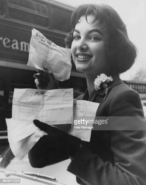 'Miss Germany' Petra Schürmann receives congratulatory telegrams at her hotel in London, after winning the 1956 'Miss World' beauty pageant, 16th...