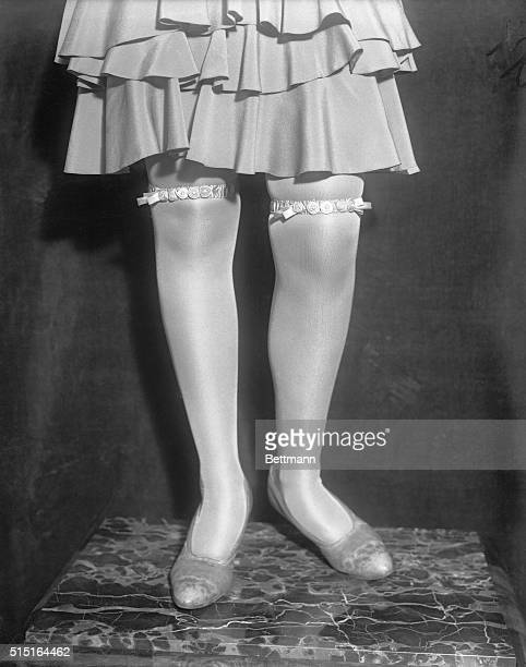 Miss Gertrude Wearing new Paris fashion She is wearinf ancy garters to prep up from under hem of short skirts