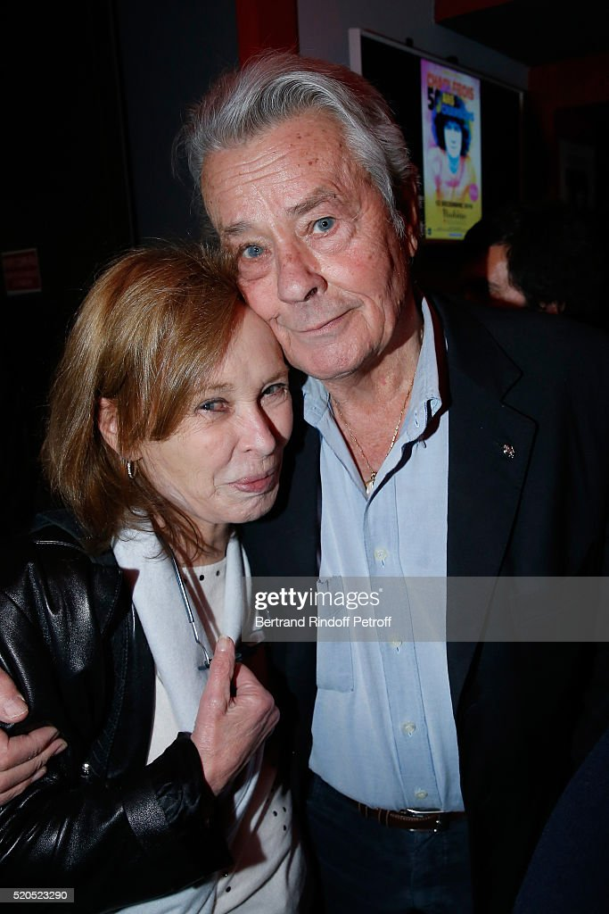 Miss Gilbert Becaud, Kitty St John, and Alain Delon pose after the