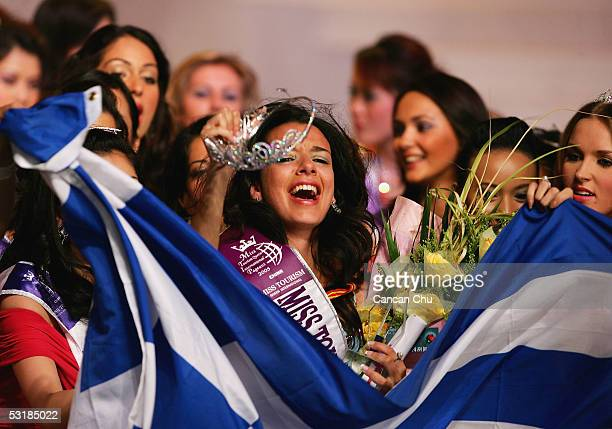Miss Greece Nikoletta Ralli celebrates with a Grecian national flag after winning the Miss Tourism Queen International 2005 Final on July 2 2005 in...