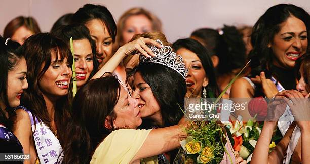 Miss Greece Nikoletta Ralli celebrates with her mother and other contestants after winning the Miss Tourism Queen International 2005 Final on July 2...