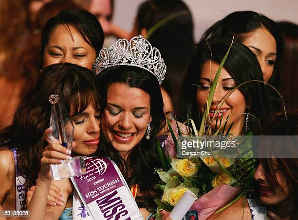 Miss Greece Nikoletta Ralli celebrates with other contestants after winning the Miss Tourism Queen International 2005 Final on July 2 2005 in...
