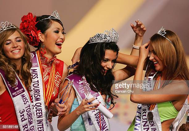 Miss Greece Nikoletta Ralli is congratulated by runners up after winning the Miss Tourism Queen International 2005 Final on July 2 2005 in Hangzhou...