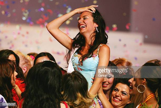 Miss Greece Nikoletta Ralli is lifted by other contestants after winning the Miss Tourism Queen International 2005 Final on July 2 2005 in Hangzhou...