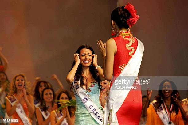 Miss Greece Nikoletta Ralli reacts after being announced Miss Tourism Queen International 2005 as Miss China Sun Jia looks at her at the World Finals...