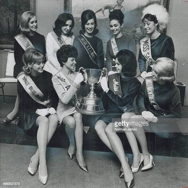 Miss Grey Cup is the title these beauties are seeking as they pose with the historic football mug From left to right they are front row Susan...