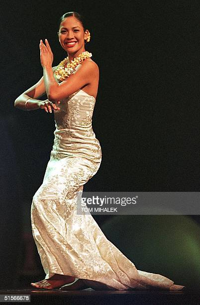 Miss Hawaii Angela Perez Baraquio performs a traditional hula dance during the talent portion of the Miss America Pageant 14 October 2000 at...
