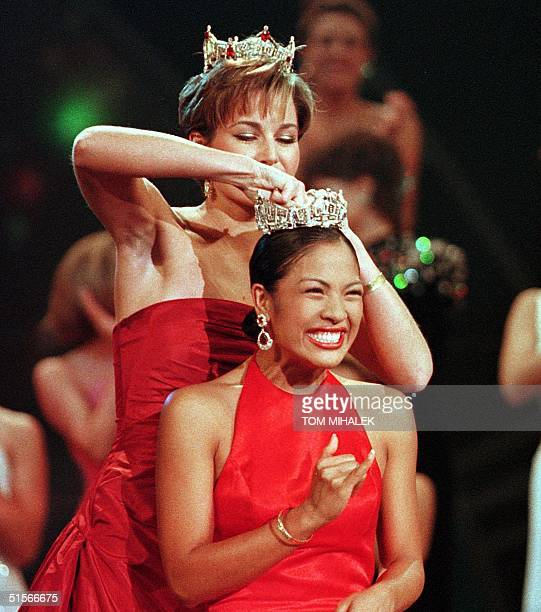 Miss Hawaii Angela Perez Baraquio reacts as she is crowned Miss America 2001 by Miss America 2000 Heather French during the Miss America Pageant 14...