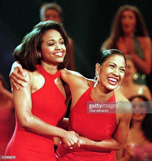 Miss Hawaii Angela Perez Baraquio reacts as she is named Miss America 2001 as she holds onto first runnerup Miss Louisiana Faith Jenkins during the...