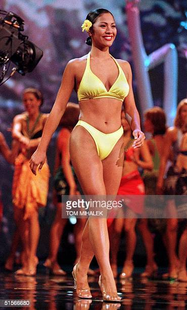 Miss Hawaii Angela Perez Baraquio walks across the stage during the swimsuit portion of the Miss America Pageant 14 October 2000 at Convention Hall...
