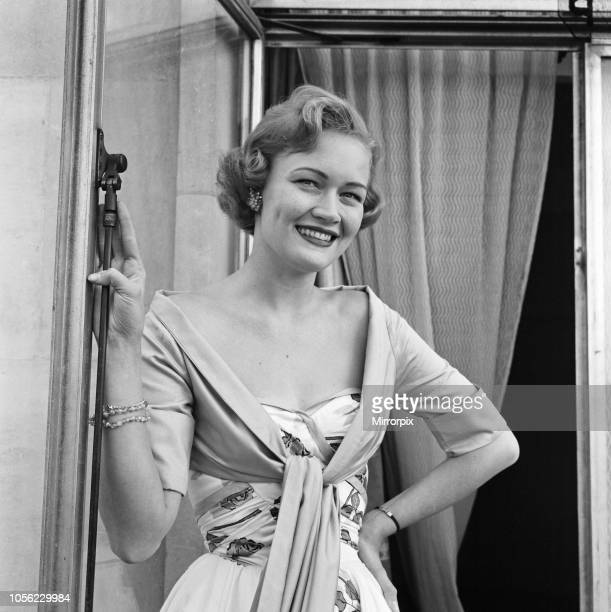 Miss Helen Landon the American Maid of Cotton for 1957 at the Westbury Hotel Conduit Street London Miss Landon comes from Huntingdon Tennessee and is...
