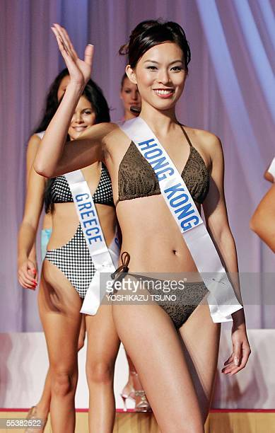 Miss Hong Kong Queenie Chu wearing a swimsuit reacts to photographers during the press preview of the 26 September Miss International Beauty Pageant...