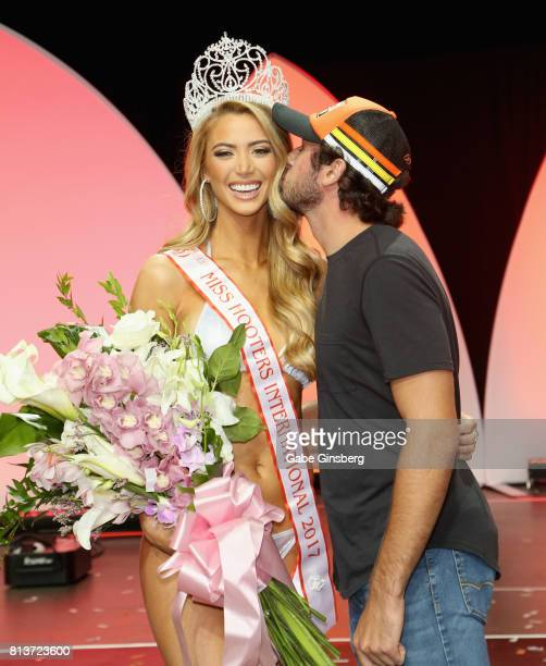 Miss Hooters International 2017 Chelsea Morgensen of Hollywood California is kissed by NASCAR Sprint Cup series driver Chase Elliott after the 21st...