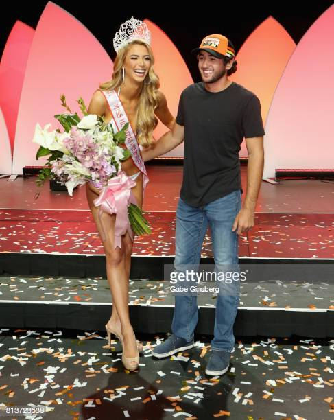 Miss Hooters International 2017 Chelsea Morgensen of Hollywood California laughs with NASCAR Sprint Cup series driver Chase Elliott after the 21st...