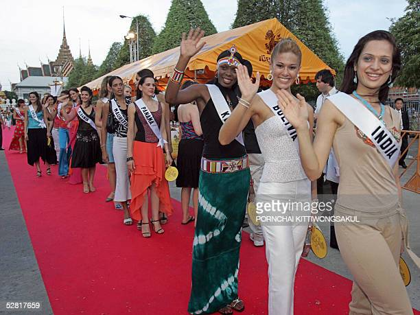 Miss India Amrita Thapar and Miss Universe 2005 contestants waves while walk on red carpet during a parade in front of the Grand Royal palace in...