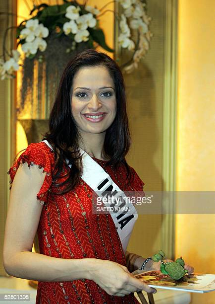 Miss India Amrita Thapar arrives at a Thai fruit introduction event in a hotel in Bangkok 12 May 2005 Organizers plan to parade the 80 contestants...