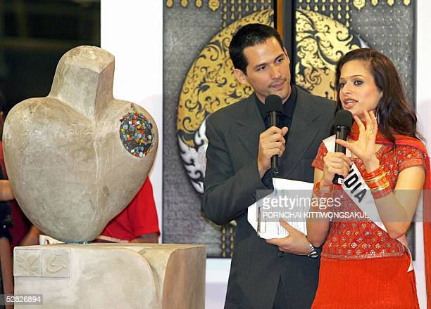 Miss India Amrita Thapar talks about her art work during a Miss universe promotional event in Bangkok 15 May 2005 The 54th annual Miss Universe...